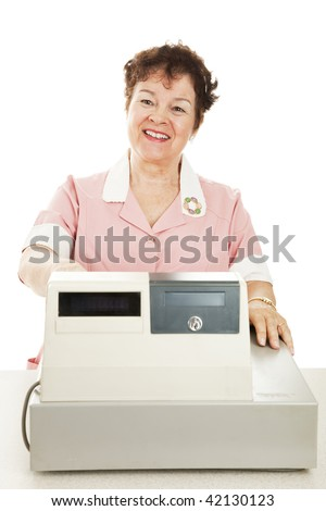Friendly smiling cashier behind her cash register.  White background. - stock photo