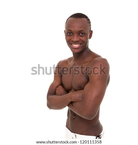 Friendly smiling muscular man posing against isolated white background