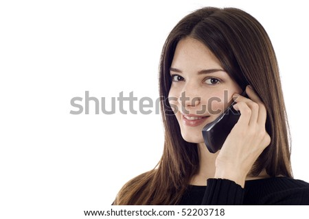 Friendly smiling woman on the phone, she's looking at the camera, a lot of copyspace - stock photo