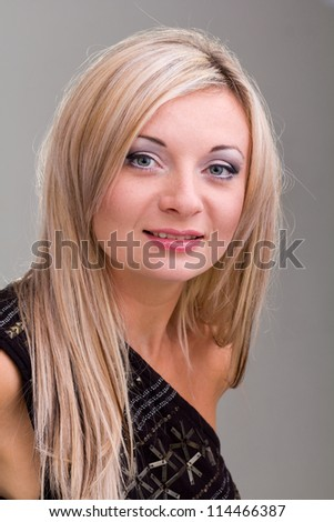 friendly smiling young woman portrait on a gray background