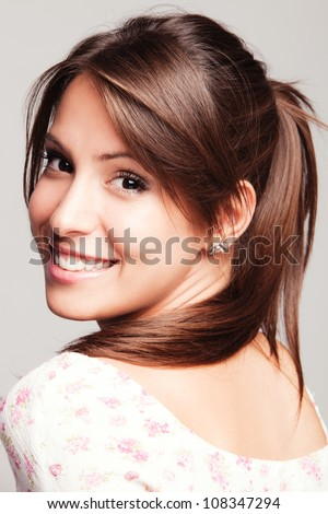 friendly smiling young woman portrait studio shot - stock photo
