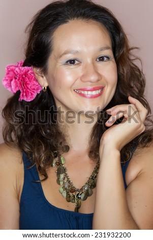 friendly smiling young woman portrait studio shot - stock photo