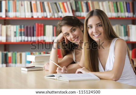 Friendly students in the library - stock photo