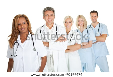 Friendly team of doctors smiling over white background - stock photo