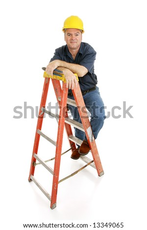 Friendly, typical construction worker on a ladder holding pliers.  Full body isolated on white. - stock photo