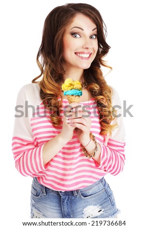 Friendly Woman Holding Ice Cream and Smiling - stock photo