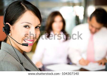 Friendly woman working as a telemarketing agent - stock photo
