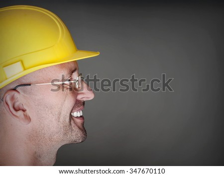 Friendly worker with hart hat - stock photo