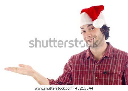 Friendly young man wearing a Christmas hat holding an imaginary product, isolated over white background