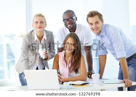Friendly young people working as a business team - stock photo