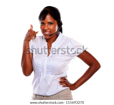 Friendly young receptionist wearing headphones saying call me against white background