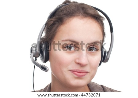 Friendly young woman with headset ready to help you