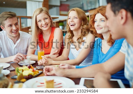 Friends at caf���© talking and laughing - stock photo