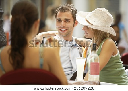 Friends at Outdoor Cafe - stock photo