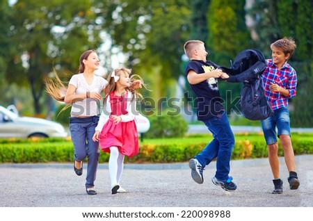 friends, boys fight on schoolyard - stock photo