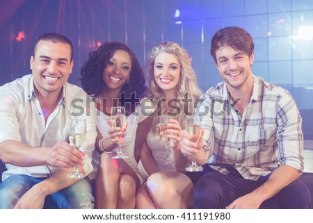 Friends celebrating with champagne in a club