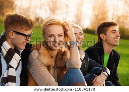 Friends chatting in the park after classes