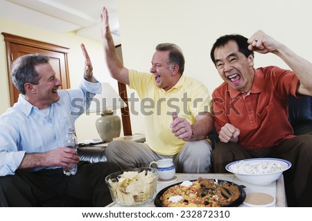 Friends Cheering for the Game - stock photo