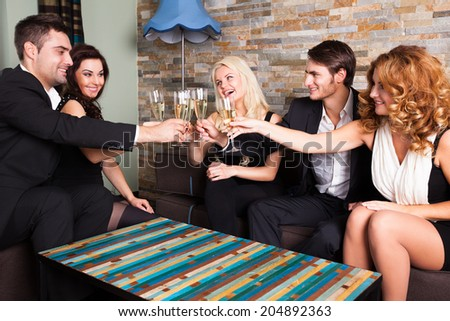 friends clinking glasses at a party