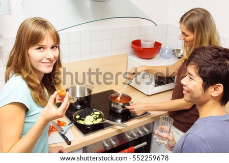 Friends Cooking Together