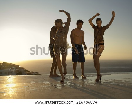 Friends dancing. - stock photo