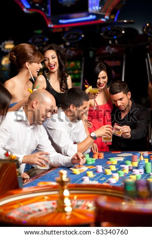 friends drinking and celebrating a gambling night - stock photo