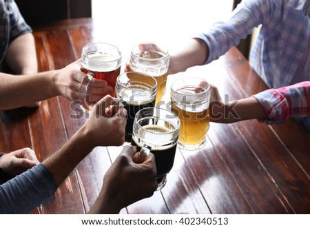 Friends drinking beer in pub