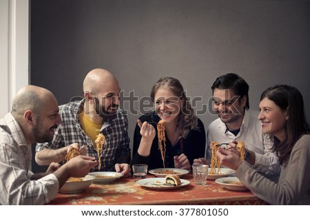 Friends eating pasta