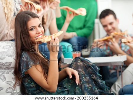 Friends eating pizza - stock photo