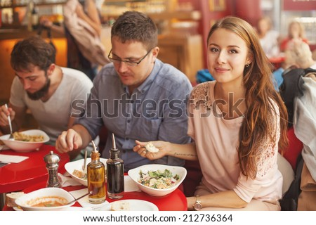 friends eating together (focus on a woman)