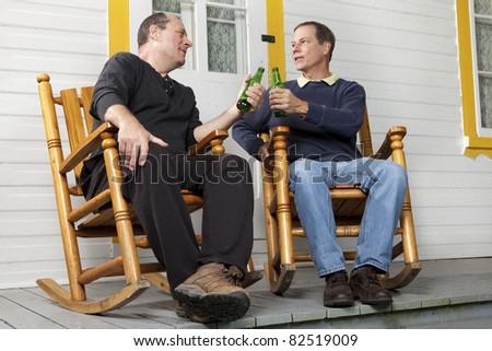 Friends enjoying a beer - stock photo