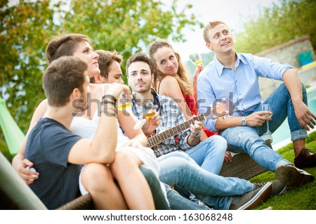 Friends enjoying at party - Stock Image - stock photo