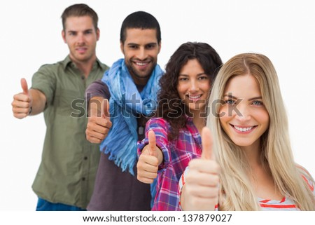 Friends giving thumbs up in a row on white background