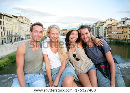 Friends - group of people on travel vacation having fun together. Two couples traveling in Florence, Tuscany, Italy, Europe. - stock photo