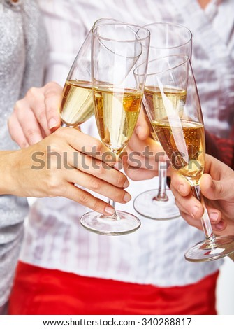 Friends hands toasting with champagne