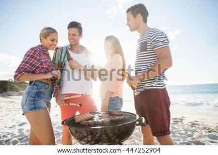 Friends having a barbecue at the beach
