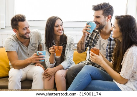 Friends having a great day at the local coffee shop - stock photo