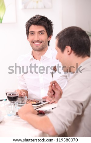 Friends having a meal together - stock photo