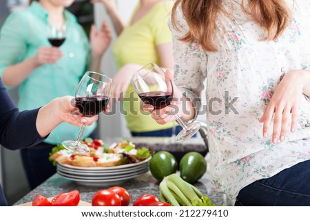 Friends having fun at home with red wine and food - stock photo