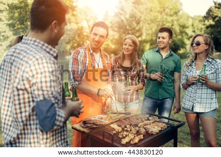 Friends having fun in nature doing bbq