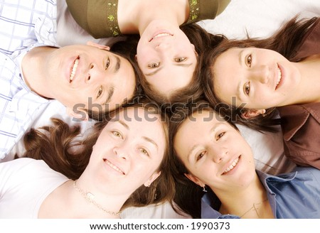 friends having fun on the floor - all smiling - stock photo