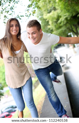 Friends having fun out in the street - stock photo