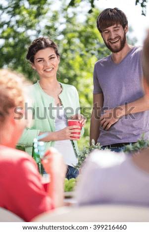 Friends having fun outdoors on a garden party - stock photo
