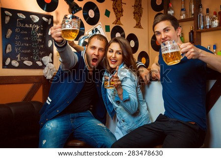 Friends having fun smiling and drink at the bar. horizontal photo - stock photo