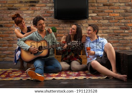 Friends having party in house - stock photo
