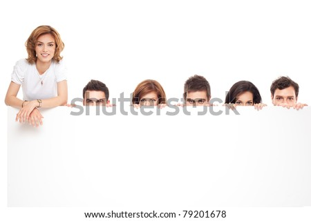 friends hiding after a blank advertising banner - stock photo