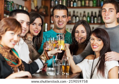 Friends in a bar - stock photo