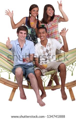 Friends in a hammock - stock photo