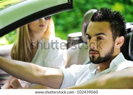 Friends in a sports car - stock photo