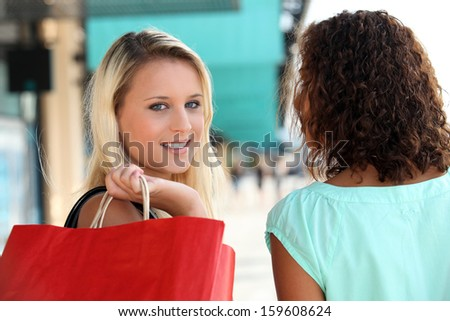 Friends in city shopping - stock photo